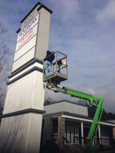 Man installing sign
